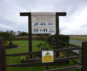 The Old Barn Retreat Touring Caravan Site main sign